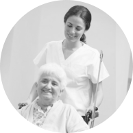 old woman in a wheelchair and a young woman behind