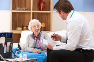 an elderly woman in her appointment with her doctor
